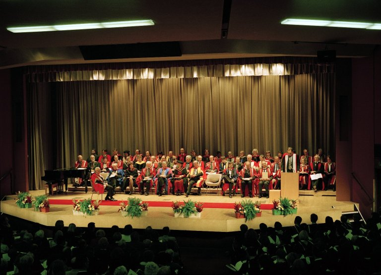 Fellows and Staff on Stage at Graduation Ceremony